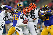 Cincinnati Bengals Quarterback Andy Dalton (14) under pressure during the International Series match between Los Angeles Rams and Cincinnati Bengals at Wembley Stadium, London, England on 27 October 2019.