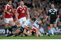 15 June 2013; Jonathan Davies, British & Irish Lions, is tackled by Jeremy Tilse and Rob Horne, NSW Waratahs. British & Irish Lions Tour 2013, NSW Waratahs v British & Irish Lions, Allianz Stadium, Sydney, NSW, Australia. Picture credit: Stephen McCarthy / SPORTSFILE