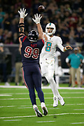 Houston Texans defensive end J.J. Watt (99) waves his arms in the air as he pressures Miami Dolphins quarterback Brock Osweiler (8) into throwing an incomplete pass on a fourth down play during the NFL week 8 regular season football game against the Miami Dolphins on Thursday, Oct. 25, 2018 in Houston. The Texans won the game 42-23. (©Paul Anthony Spinelli)