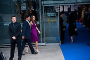 Arun Nayar; Elizabeth Hurley, Ark fundraising dinner and auction. ( Absolute Return for Kids ) Old Eurostar Terminal. Waterloo Station. London. 4 June 2009