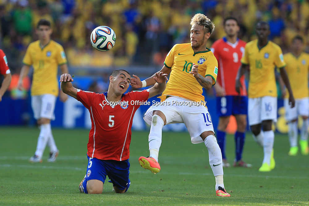 28th June 2014 - FIFA World Cup - Round of 16 - Brazil v Chile - Neymar of Brazil gets past Francisco Silva of Chile - Photo: Simon Stacpoole / Offside.