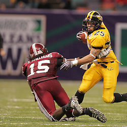 21 December 2008: Southern Miss running back Damion Fletcher (25) gets by the tackle of Troy defensive back Tavares Williams (15) during a 30-27 overtime victory by the Southern Mississippi Golden Eagles over the Troy Trojans in the  R+L Carriers New Orleans Bowl at the New Orleans Superdome in New Orleans, LA.