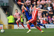 Ollie Rathbone is challenged by Dylan McGeouch during the EFL Sky Bet League 1 match between Rochdale and Sunderland at Spotland, Rochdale, England on 6 April 2019.