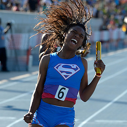 Serra's Jasmin Reed rects after running the last leg of the 4x100 relay as Serra wins during the 99th annual CIF State Track & Field Championships in Veterans Memorial Stadium at Buchanan High School in Clovis, Calif., on Saturday, June 03, 2017.