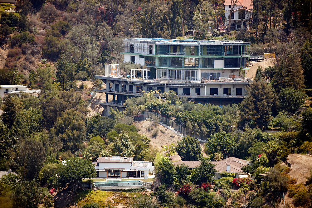 Crews work on demolishing part of the mansion of Mohamed Hadid at 901 Strada Vecchia located above the home of Joseph Horacek, in the Bel Air neighborhood on Wednesday, June 29, 2016 in Los Angeles, Calif. © 2016 Patrick T. Fallon for MailOnline