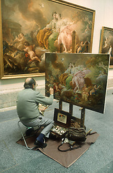 Painter working at easel with paints; making copy of old painting in Prado Museum; Madrid,
