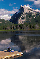 Woman reading at Mount Rundle, Alberta Canada