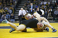 January 29, 2010: Penn State's Cyler Sanderson and Iowa's Jake Kerr in the 157-pound bout at Carver-Hawkeye Arena in Iowa City, Iowa on January 29, 2010. Kerr won the match 4-2 and Iowa defeated Penn State 29-6.