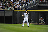 CHICAGO - JULY 26:  Carlos Quentin #20 of the Chicago White Sox catches a fly ball against the Seattle Mariners on July 26, 2010 at U.S. Cellular Field in Chicago, Illinois.  The White Sox defeated the Mariners 6-1.  (Photo by Ron Vesely)