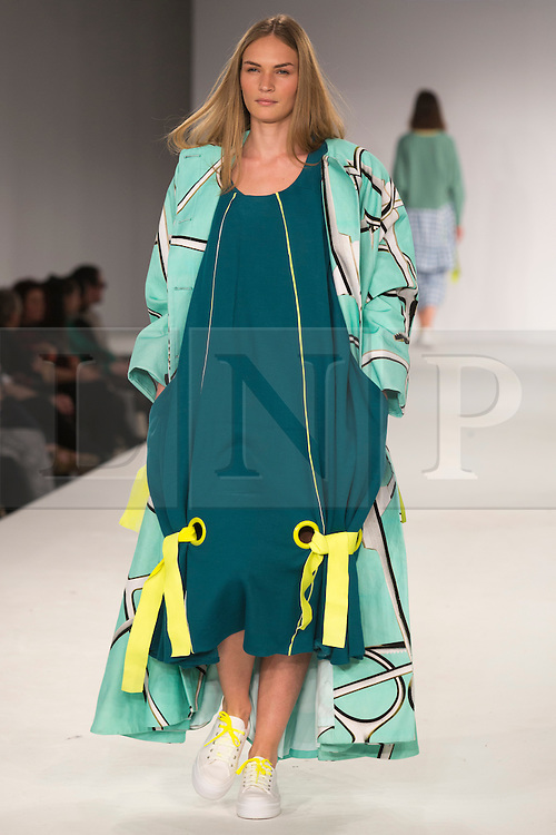 © Licensed to London News Pictures. 31/05/2014. London, England. Collection by Alexandra Huxtable from UEL, University of East London. Graduate Fashion Week 2014, Runway Show at the Old Truman Brewery in London, United Kingdom. Photo credit: Bettina Strenske/LNP