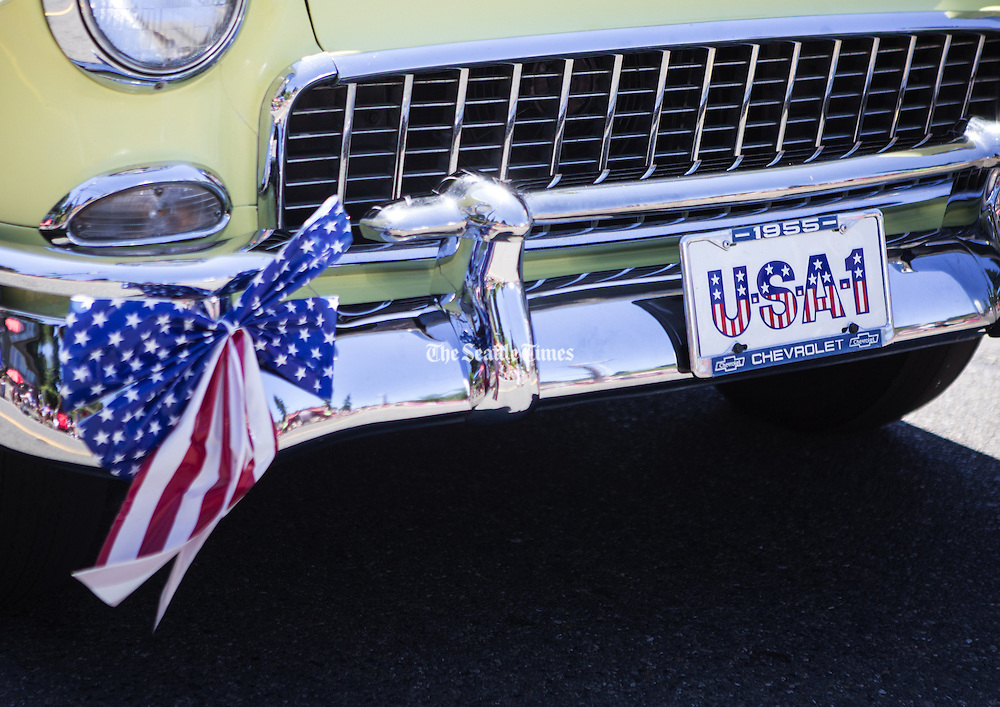 A 1955 Chevrolet rolls by with &quot;USA-1&quot; in the license plate holder during the annual Freedom Festival in Bothell on  July 4.<br /> <br /> Lindsey Wasson / The Seattle Times