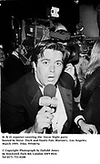 H. B. O. reporter covering the  Oscar Night party hosted by Steve Tisch and Vanity Fair. Morton's. Los Angeles. March 1995. 95548/5a<br />© Copyright Photograph by Dafydd Jones<br />66 Stockwell Park Rd. London SW9 0DA<br />Tel 0171 733 0108