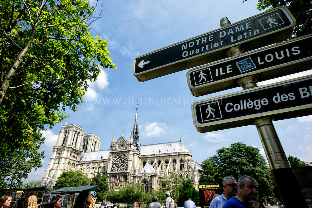 Notre Dame Cathedral and Signage, taken from the Seine River Art Stand, Paris, France