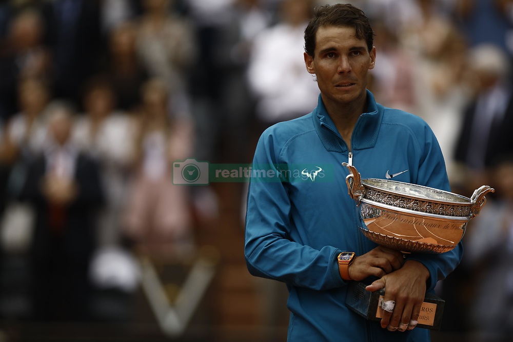June 10, 2018 - Paris, Ile-de-France, France - Rafael Nadal of Spain poses with the trophy after beating Dominic Thiem of Austria 6-4 6-3 6-2 in the final of the French Open men's singles at Roland Garros on June 10, 2018 in Paris, France. (Credit Image: © Mehdi Taamallah/NurPhoto via ZUMA Press)