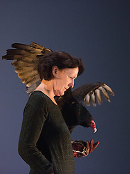 "© Licensed to London News Pictures. 06/05/2014. London, England. Pictured: Fiona Shaw performing with Inti, a six-year old Turkey Vulture (Cathartes aura). ""The Testament of Mary"" performed by actress Fiona Shaw at the Barbican Theatre, London. Running from 1 to 25 May 2014. Directed by Deborah Warner based on the novel by Colm Tóibín. Photo credit: Bettina Strenske/LNP"