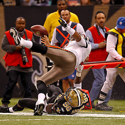 January 2, 2011; New Orleans, LA, USA; New Orleans Saints defensive end Alex Brown (96) is called for a horse collar penalty in taking down Tampa Bay Buccaneers quarterback Josh Freeman (5) during the fourth quarter at the Louisiana Superdome. The Buccaneers defeated the Saints 23-13. Mandatory Credit: Derick E. Hingle