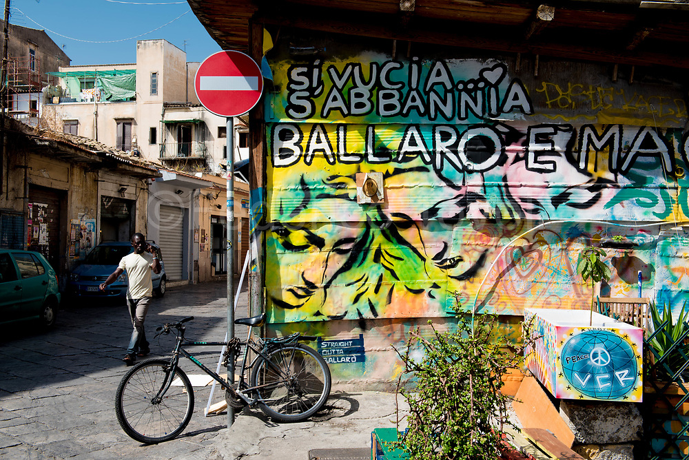 """At the Ballarò Market, actually the most multiethnic area of the city. """"It sounds and screams. Ballarò is a spell, """"says the writing"""