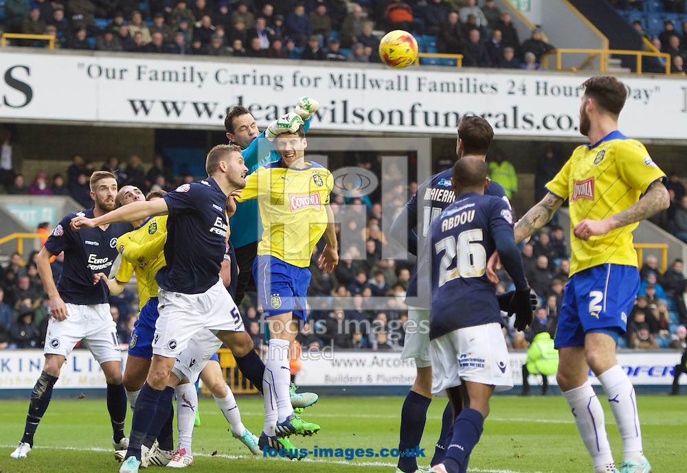 Goalkeeper David Forde of Millwall punches the ball clear during the Sky Bet Championship match at The Den, London<br /> Picture by Alan Stanford/Focus Images Ltd +44 7915 056117<br /> 07/02/2015