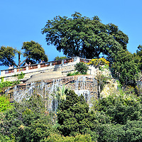 Cascade Donjon in Parc du Chateau in Nice, France <br /> The panoramic view of Vieux Nice or the Old Town of Nice, plus the beaches that run along the Mediterranean&rsquo;s Bay of Angels, is spectacular from this observation platform above a 300 foot, artificial waterfall that was built in the 18th century.  The Cascade Donjon is located in the Parc du Chateau which is on Castle Hill at the east end of town.  It was a defense fortification from the 13th through the 17th century until it was destroyed by the King of France in 1706.