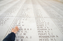 Pic Shows A young boy reading the names on the Menin Gate memorial.<br /> The Duke of Edinburgh at the Menin Gate in Ypres, Belgium, at a ceremony on Armistice Day to mark the gathering of soil for the Flanders Fields Memorial Garden at the Guards Museum in London, United Kingdom. Monday, 11th November 2013. Picture by i-Images