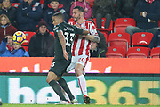 Gabriel Jesus and Geoff Cameron during the Premier League match between Stoke City and Manchester City at the Bet365 Stadium, Stoke-on-Trent, England on 12 March 2018. Picture by Graham Holt.