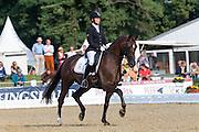 Inna Tzydrenkova - Florimax<br /> FEI World Breeding Dressage Championships for Young Horses 2012<br /> © DigiShots