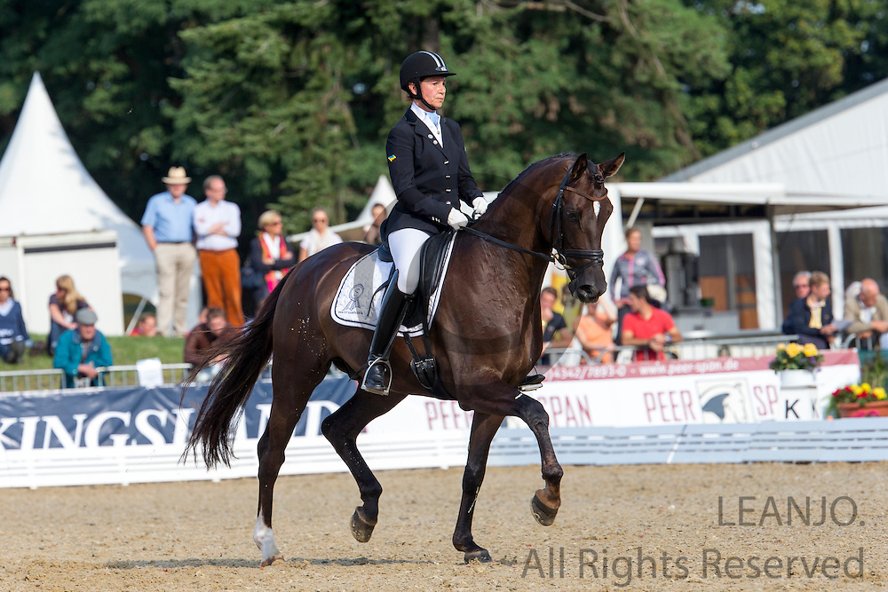 Inna Tzydrenkova - Florimax<br /> FEI World Breeding Dressage Championships for Young Horses 2012<br /> © DigiShots