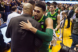 Jan 10, 2017; Morgantown, WV, USA; Baylor Bears guard Ishmail Wainright (24) talks with a West Virginia Mountaineers assistant coach after the game at WVU Coliseum. Mandatory Credit: Ben Queen-USA TODAY Sports