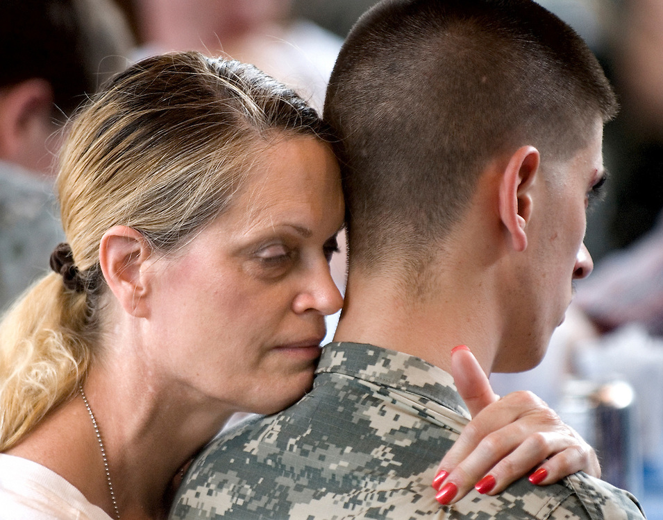 Barbara Dixon, of Ashburn holds onto her son, Pfc. Greg Dixon, 20, at the National Guard Armory in Harrisonburg, before his deployment to Iraq oon Monday.