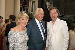 Left to right, SIR EVELYN & LADY DE ROTHSCHILD and GEORDIE GRIEG at the Tatler Summer Party in association with Moschino at Home House, 20 Portman Square, London W1 on 29th June 2005.<br />