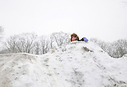 Six-year old Brianna Harvey of Brick envisions her next ride down the sledding hill located next to the Howell Township Library in Howell, New Jersey on February 26, 2010.  Children of all ages took advantage of the fresh snow left over from winter season's fourth major snowstorm.