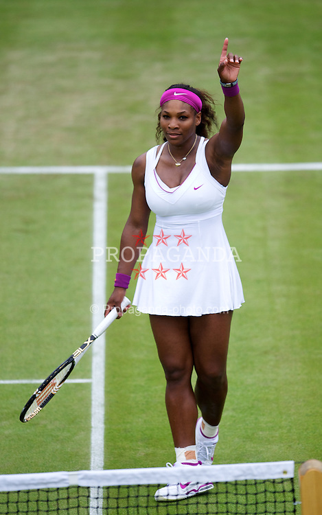 LONDON, ENGLAND - Tuesday, June 26, 2012: Serena Williams (USA) celebrates winning the Ladies' Singles 1st Round match on day two of the Wimbledon Lawn Tennis Championships at the All England Lawn Tennis and Croquet Club. (Pic by David Rawcliffe/Propaganda)