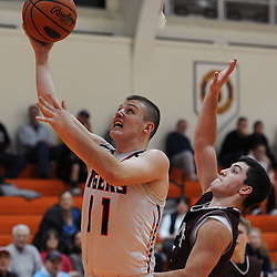 TOM KELLY IV &mdash; DAILY TIMES<br /> Marple Newtown's Jake McGee (11) goes up for a layup and gets fouled by Garnet Valley's Jack Diggory (21) during the Garnet Valley at Marple Newtown boys basketball game on Tuesday night December 9, 2014.