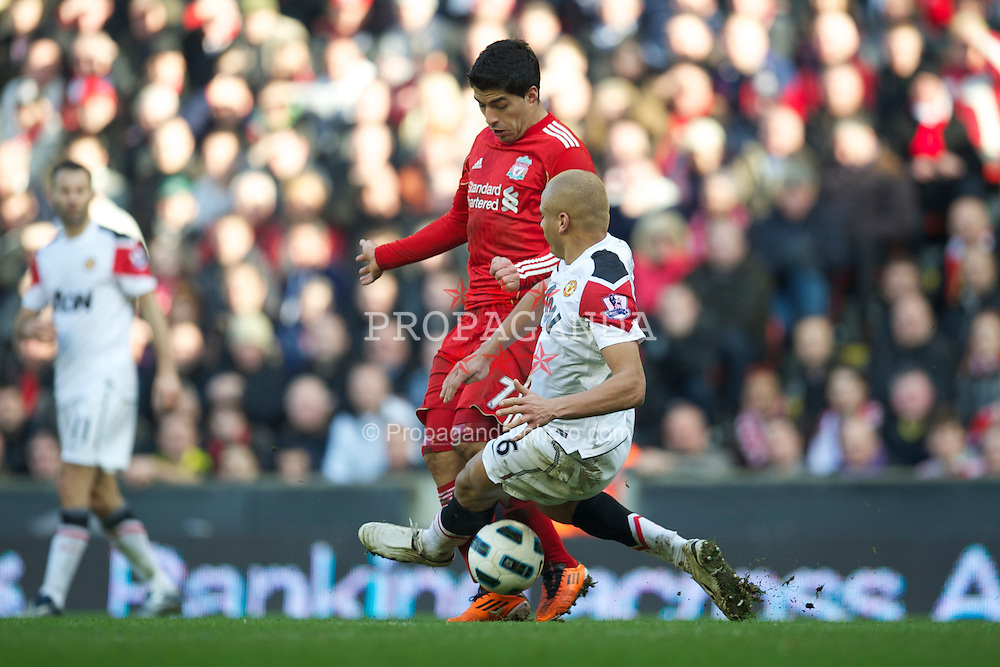 LIVERPOOL, ENGLAND - Sunday, March 6, 2011: Liverpool's Luis Alberto Suarez Diaz and Manchester United's Wes Brown during the Premiership match at Anfield. (Photo by David Rawcliffe/Propaganda)