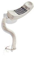 Broken corded phone on white background