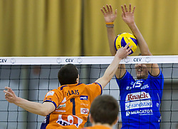 Andrej Flajs of ACH vs Ryan Ammerman of Knack Roeselare during volleyball match between ACH Volley (SLO) and Knack Roeselare (BEL) at Quarterfinals of CEV Challenge Cup 2011/2012, on February 8, 2012 in Arena Tivoli, Ljubljana, Slovenia. ACH Volley defeated Knack Roeselare 3-0. (Photo By Grega Valancic / Sportida.com)