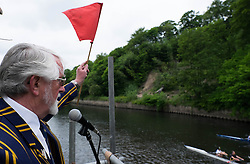 © Licensed to London News Pictures.13/06/15<br /> Durham, England<br /> <br /> A marshall prepares to start one of the heats during the 182nd Durham Regatta rowing event held on the River Wear. The origins of the regatta date back  to commemorations marking victory at the Battle of Waterloo in 1815. This is the second oldest event of this type in the country and attracts over 2000 competitors from across the country.<br /> <br /> Photo credit : Ian Forsyth/LNP