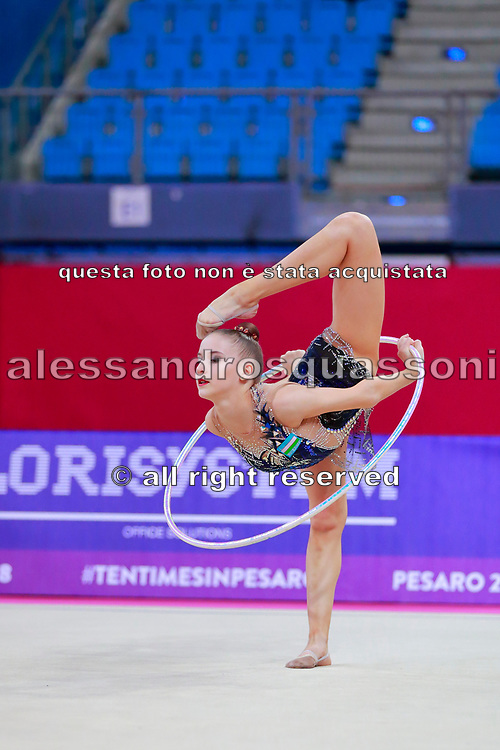 Tashkenbaeva Sabina  from Uzbekistan during qualifying at hoop in Pesaro World Cup 13 April, 2018. Sabina was born in Tashkent 2000. She began competing in gymnastics at age six. His dream is to participate in the upcoming Tokyo Olympics in 2020.