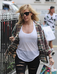 Singer Ellie Goulding and boyfriend Dougie Poynter back in London after their recent holiday in Ibiza. The Burn singer wearing a check shirt, white vest top and ripped jeans went to TopShop personal shopping with Dougie, before grabing a takeaway and wearing a baseball cap with the words Sex On The Beach... UK. 09/08/2014 <br />BYLINE MUST READ : GOTCHAIMAGES.COM<br /><br />Copyright by © Gotcha Images Ltd. All rights reserved.<br />Usage of this image is conditional upon the acceptance <br />of Gotcha Images Ltd, terms and conditions available at<br />www.gotchaimages.com
