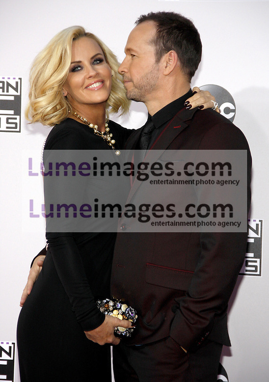 Jenny McCarthy and Donnie Wahlberg at the 2014 American Music Awards held at the Nokia Theatre L.A. Live in Los Angeles on November 23, 2014 in Los Angeles, California. Credit: Lumeimages.com