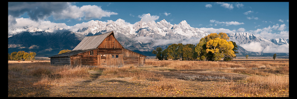 Changing cottonwoods and early snow on the Grand Teton mountain range become harbingers of the Winter season.