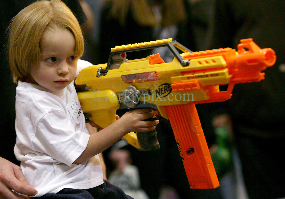29 Jan 2012. New Orleans, Louisiana USA. <br /> William Fontenot (4yrs)  takes aim at Star Wars and comic book characters gathered at the Wizard World New Orleans Comic Con at the Ernest N Morial Convention Center. <br /> Photo; Charlie Varley/varleypix.com