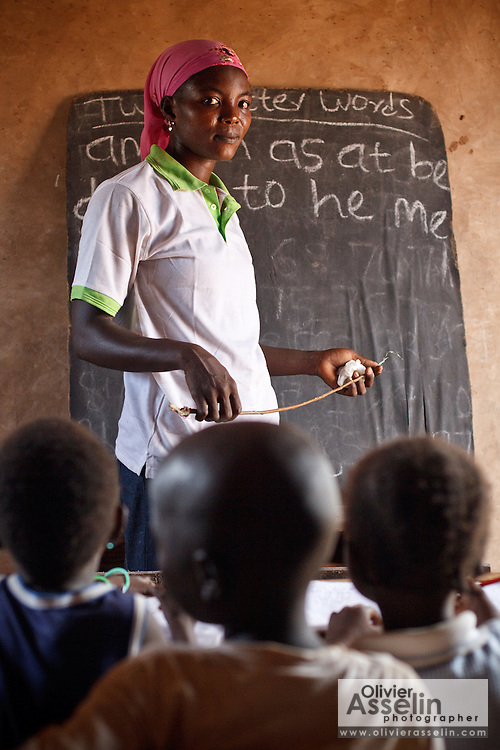Abdulai Sadia teaches children in the community of Kunayili, near Gushegu, Northern Ghana, on Wednesday November 2, 2011.