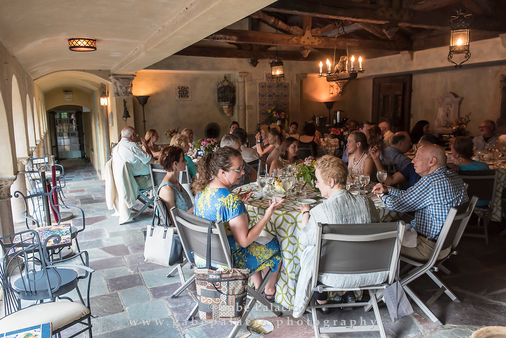 Dining in the Summer Dining Room during A Summer Evening at the Rosens&rsquo; at Caramoor in Katonah New York on July 22, 2016. <br /> (photo by Gabe Palacio)
