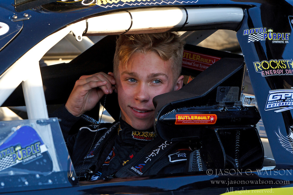 ROSEVILLE, CA - OCTOBER 13: Dylan Kwasniewski, driver of the #03 Rockstar/Royal Purple Ford sits in his car during qualifying for the NASCAR K&N Pro Series West Toyota/NAPA 150 at the All American Speedway on October 13, 2012 in Roseville, California. (Photo by Jason O. Watson/Getty Images for NASCAR) *** Local Caption *** Dylan Kwasniewski