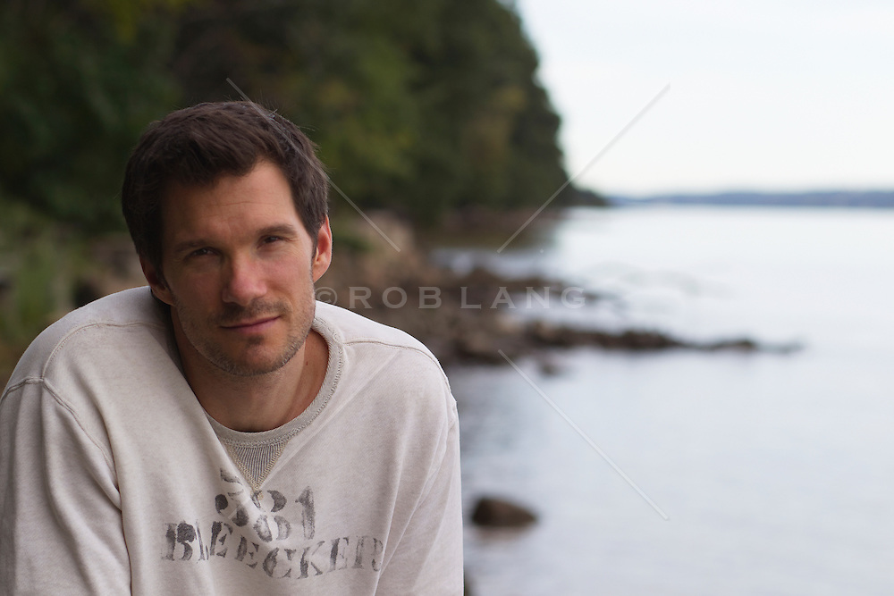 portrait of a handsome forty something year old man by The Hudson River in New Jersey