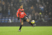 Patrice Evra of Manchester United controls the ball in the rain. Portsmouth v Manchester United (1-4), Barclays Premier League Fratton Park, Portsmouth, 28th November 2009.