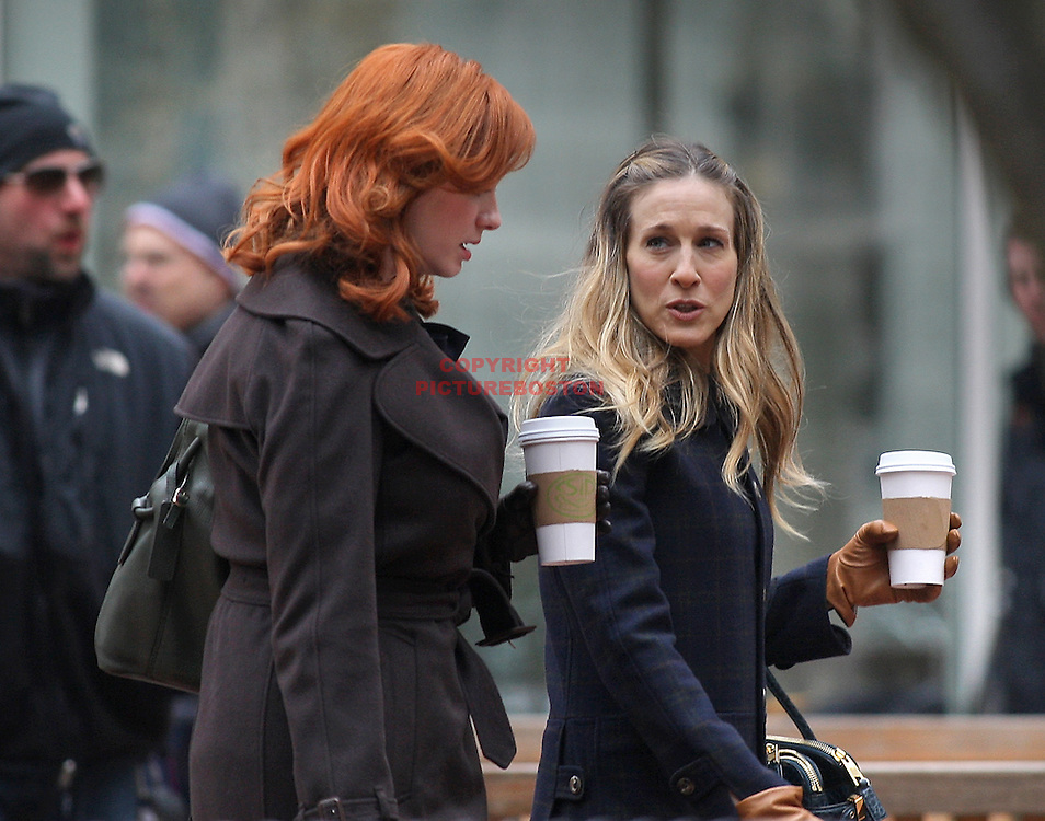 "Sarah Jessica Parker and Christina Hendricks, with red hair, are seen in Post Office Square this morning, March 9, 2011, while shooting scenes from their upcoming movie  ""I Don't Know How She Does It"""