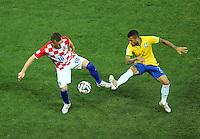 Ivica Olic of Croatia and Daniel Alves of Brazil