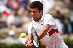 May 30, 2018 - Paris, France - Novak Djokovic of Serbia returns the ball to Jaume Munar of Spain during the second round at Roland Garros Grand Slam Tournament - Day 4. (Credit Image: © Mehdi Taamallah/NurPhoto via ZUMA Press)